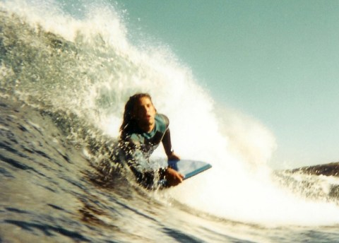 A Surfer catching a wave.