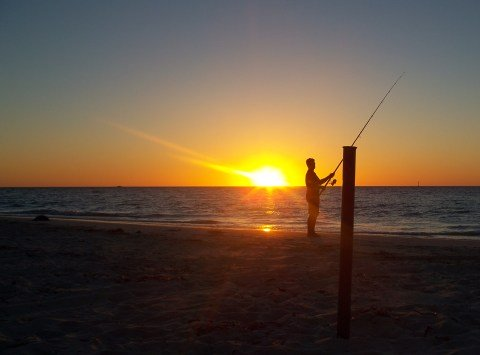 Fishing at sunset.